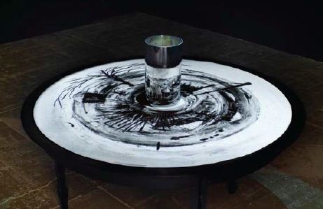 William Kentridge, What will come, 2007, Anamorphic projection: 35 mm film transferred to DVD; 8 min., 40 sec: cold rolled steel table, Courtesy of Marian Goodman Gallery, New York