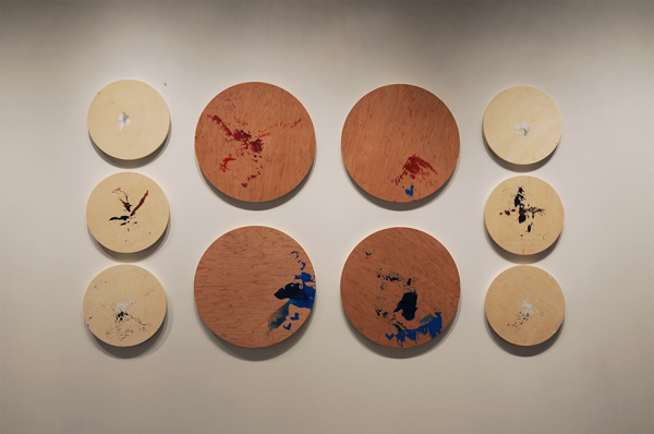 Christine Sun Kim, Speaker drawings #1-#10, 2012, Ink and powder-drenched quills on round wood panels, 16