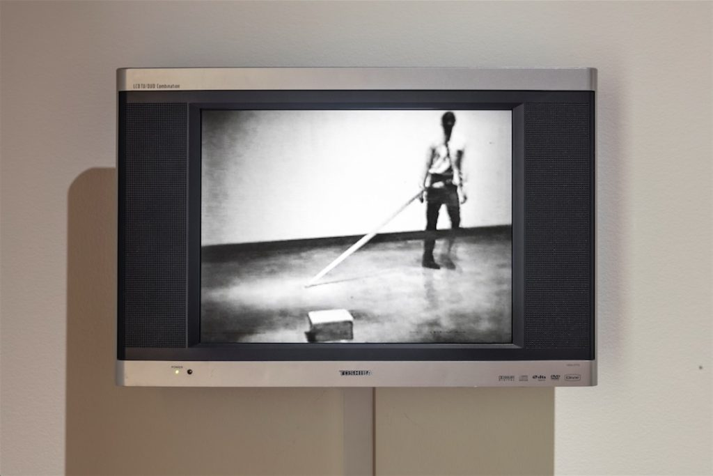 Mowry Baden, Untitled (Seat Belt with Concrete Block), 1969–1970, Nylon, metal, concrete, Dimensions variable, Collection of the Vancouver Art Gallery (original video documentation)